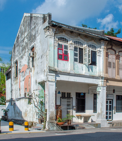 Falling into dereliction, a crumbling, but still occupied Shophouse near Nicoll Highway mrt, Singapore.